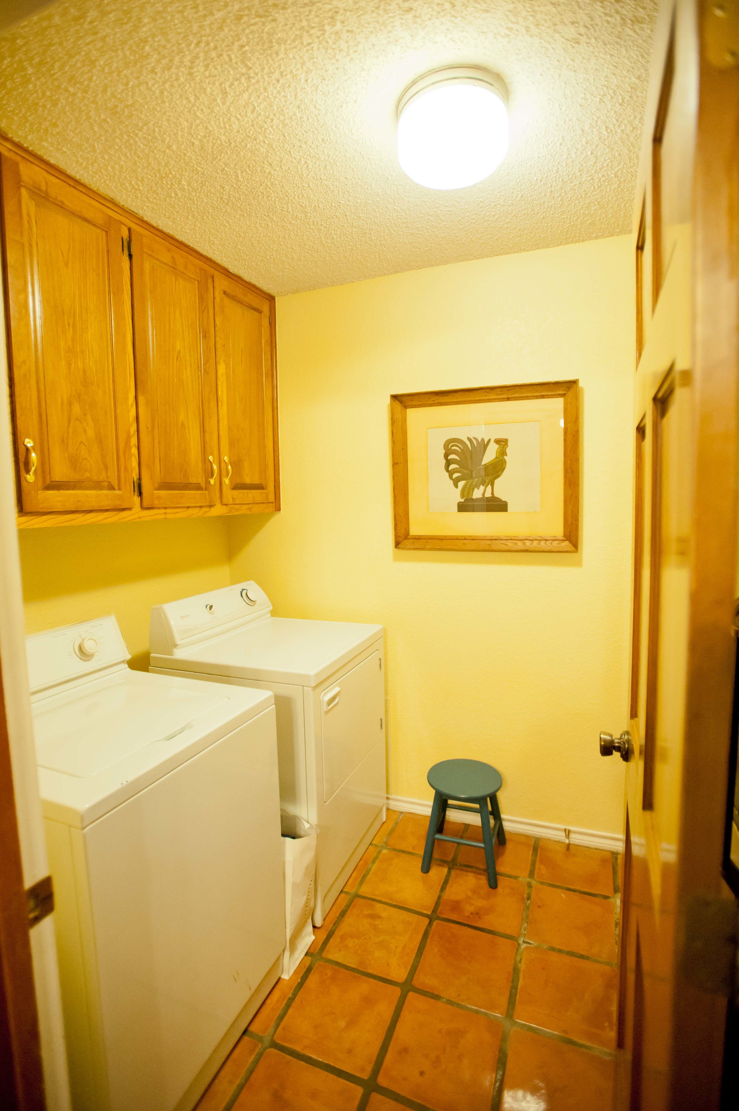 Before: Just the laundry room...no 'before' picture of the water heater closet area.  When we bought this house, I was honestly worried about hating having a laundry room downstairs, off the kitchen and as far away as possible from the home's bedrooms.  I know, I may have been missing the forest for the trees.      Actually, it's been not bad at all (yes, Wes does the lion's share of the laundry because he's awesome) -- having it on the main floor is kind of nice.  Who knew.