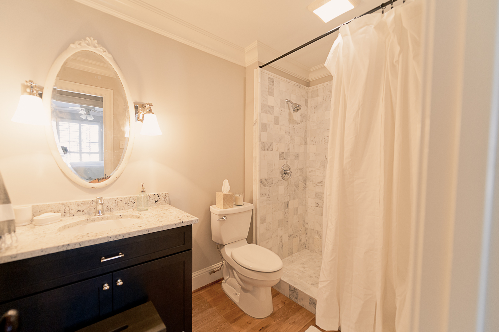 After: New walk-in shower, vanity, lighting, floors, trim and paint.