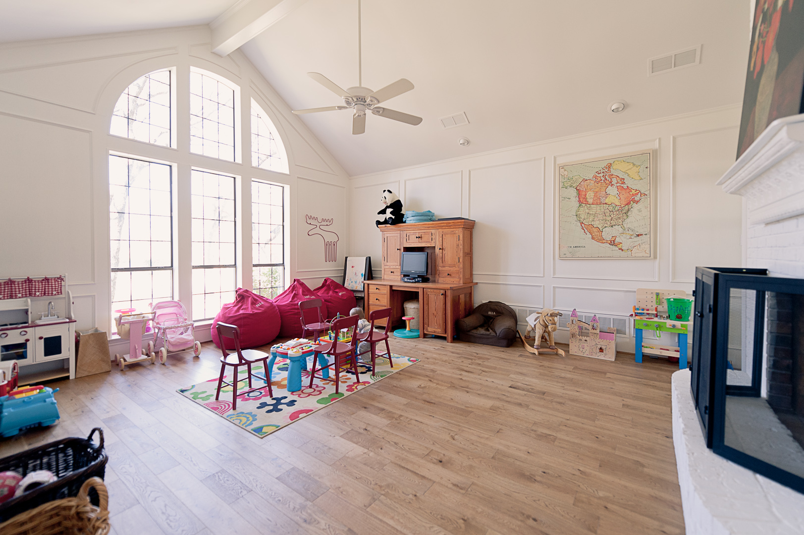 After: Our lament about this room is that it has the home's only fireplace.  One day, I see it being used as a media room or family space that more than just the kids will enjoy.  Of course, if Matt has his way, it'll be reborn as a killer office when the kids are a bit older.