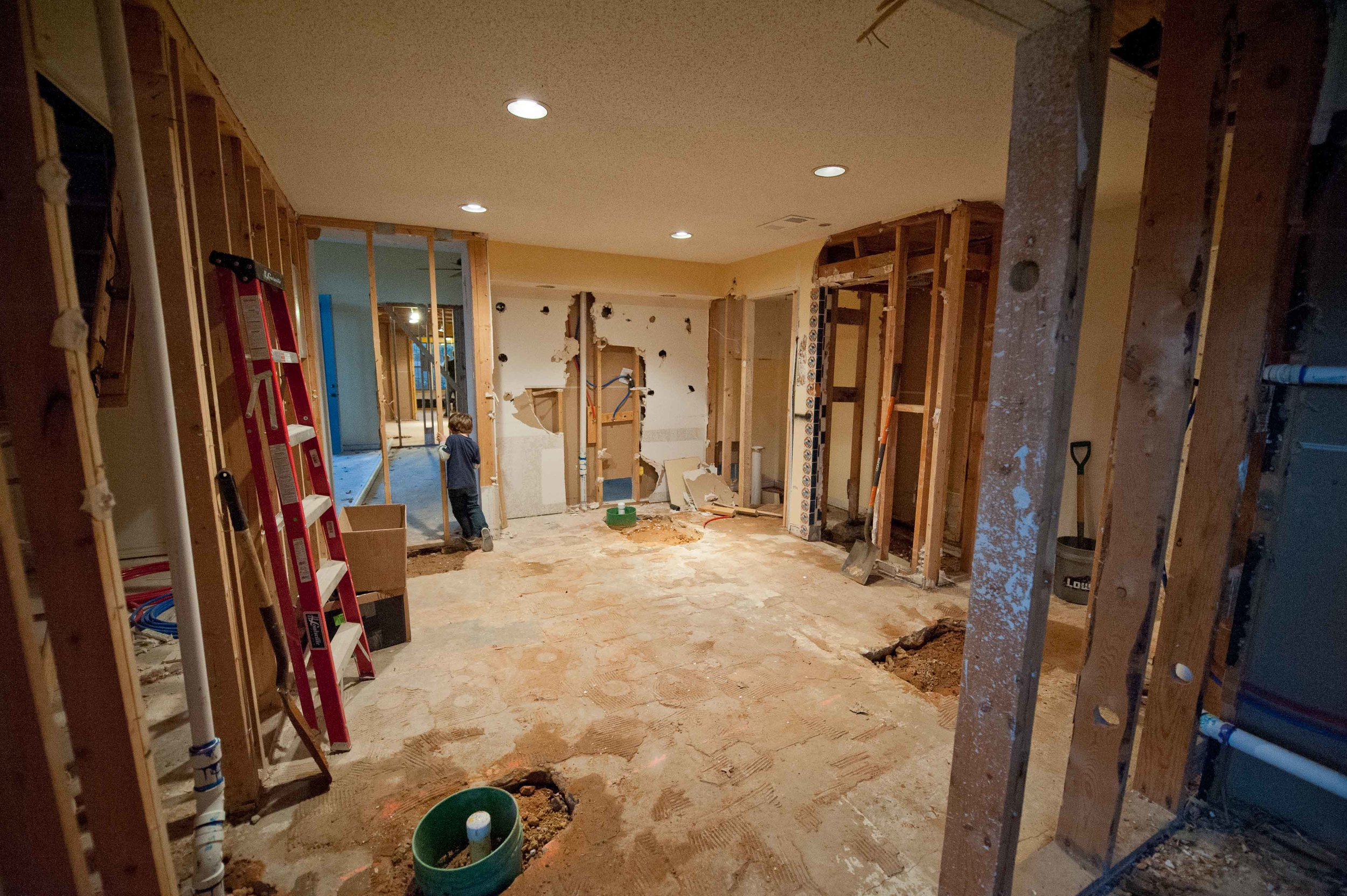 During: And this was after the gaping hole in the middle of the room was filled in. If you look closely, you can see through the family room, into the kitchen through the framing on the left.