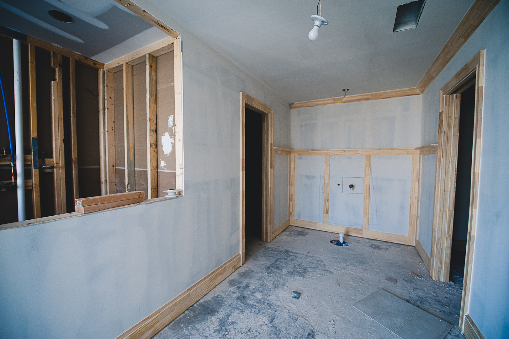 Looking the same direction, now the wall to the left has been bumped out to expand the closet and frame in the new location for the shower.  Where the old shower was, is an expanded potty room.