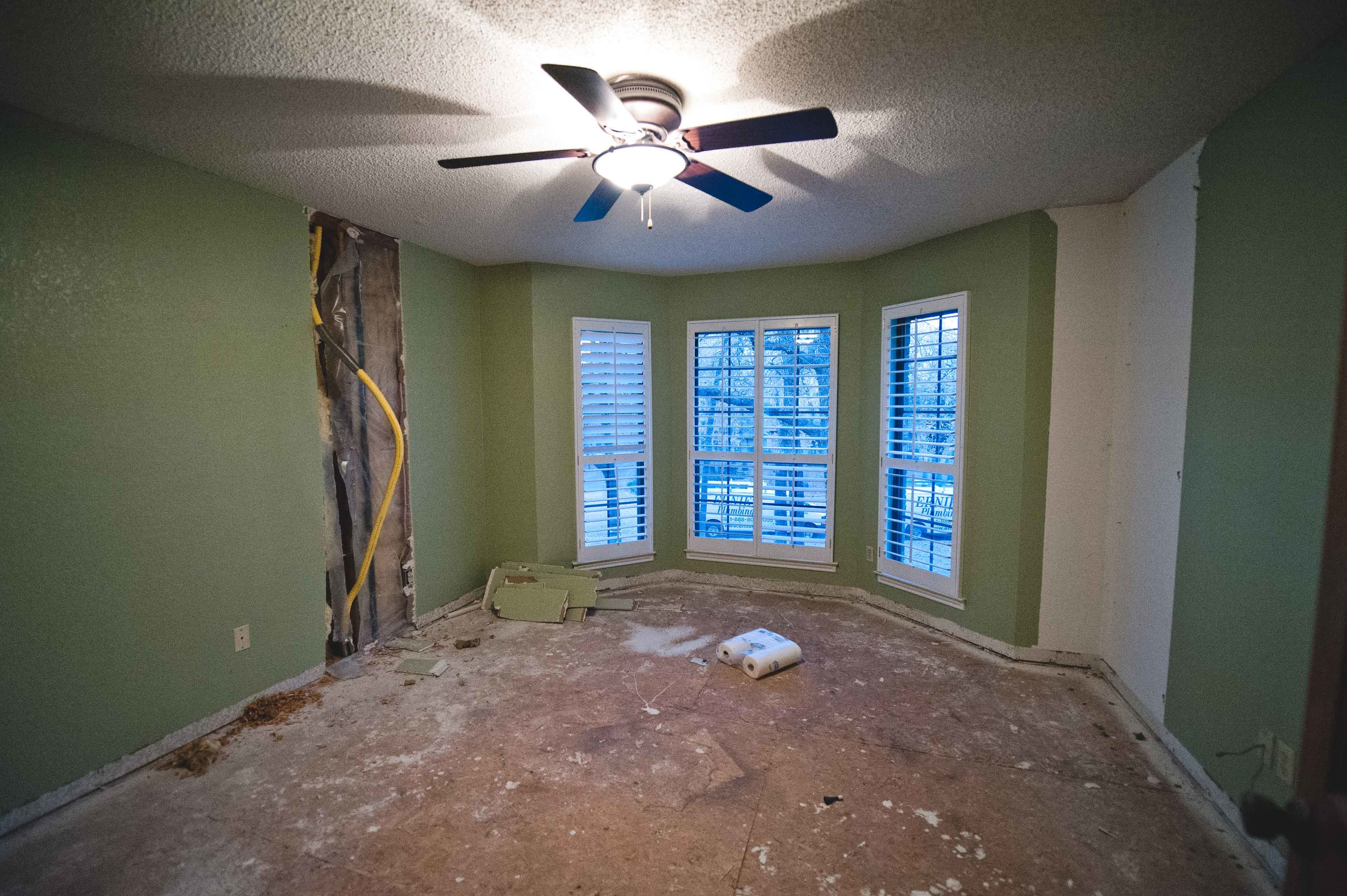 During: Another built-in bit the dust.  And oooh, you can really see the old popcorn ceilings in this image.