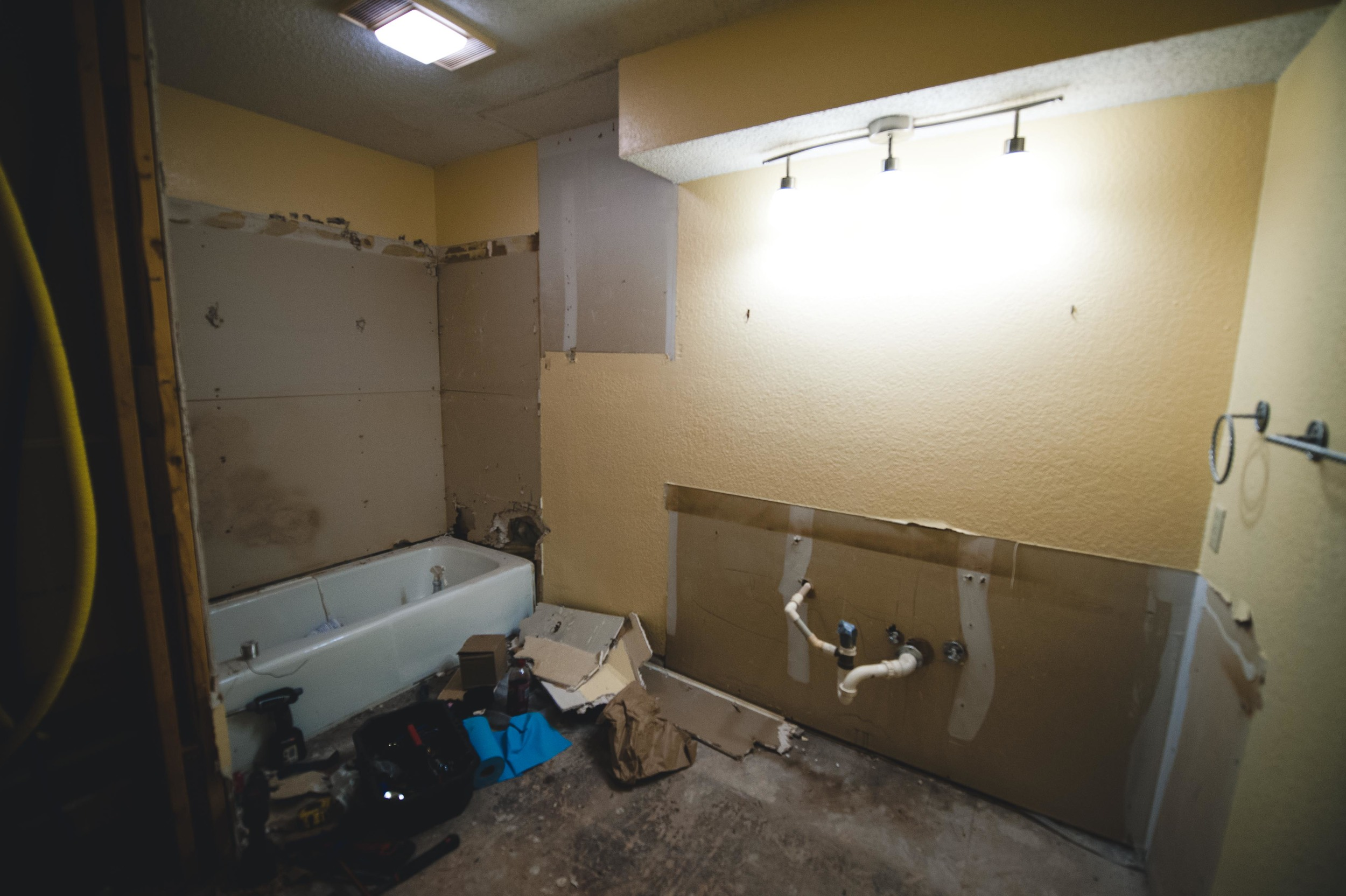 During: We saved the tub, but lost the over-potty cabinet, the lighting bulkhead and, well, everything else.