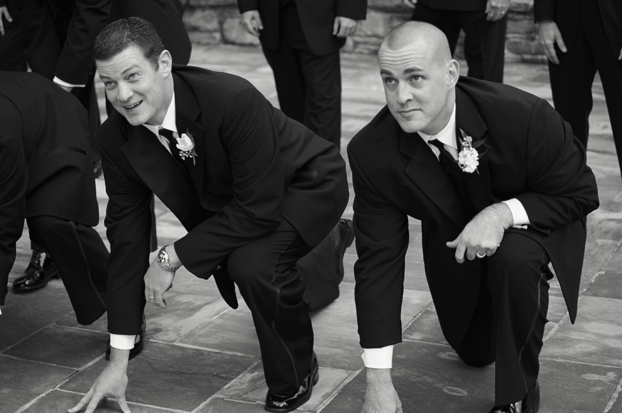 Ah, the early 2000's and the ever-popular football pose for the groomsmen.