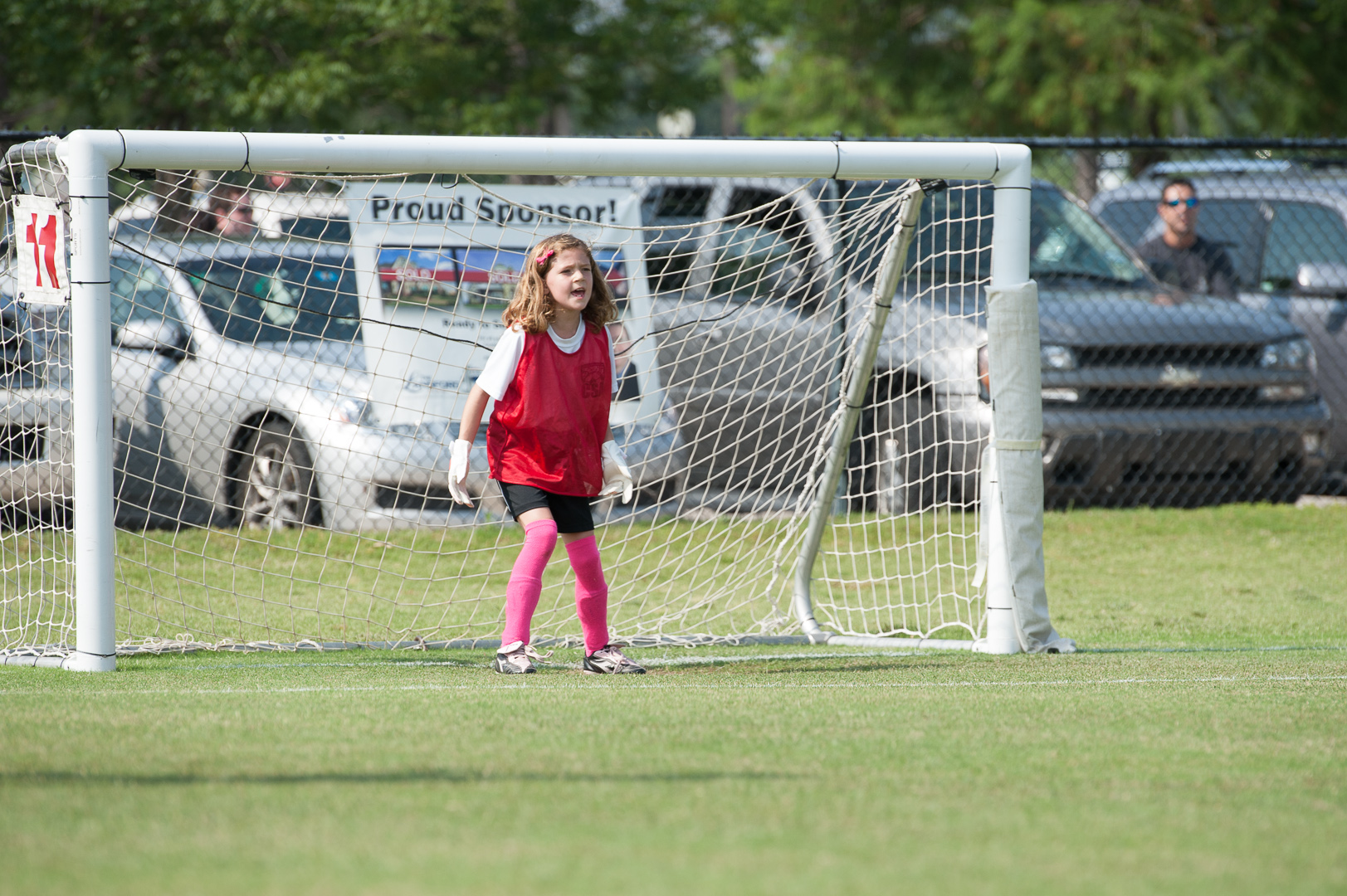 Ella cheers on her team non-stop from her spot playing goalie.