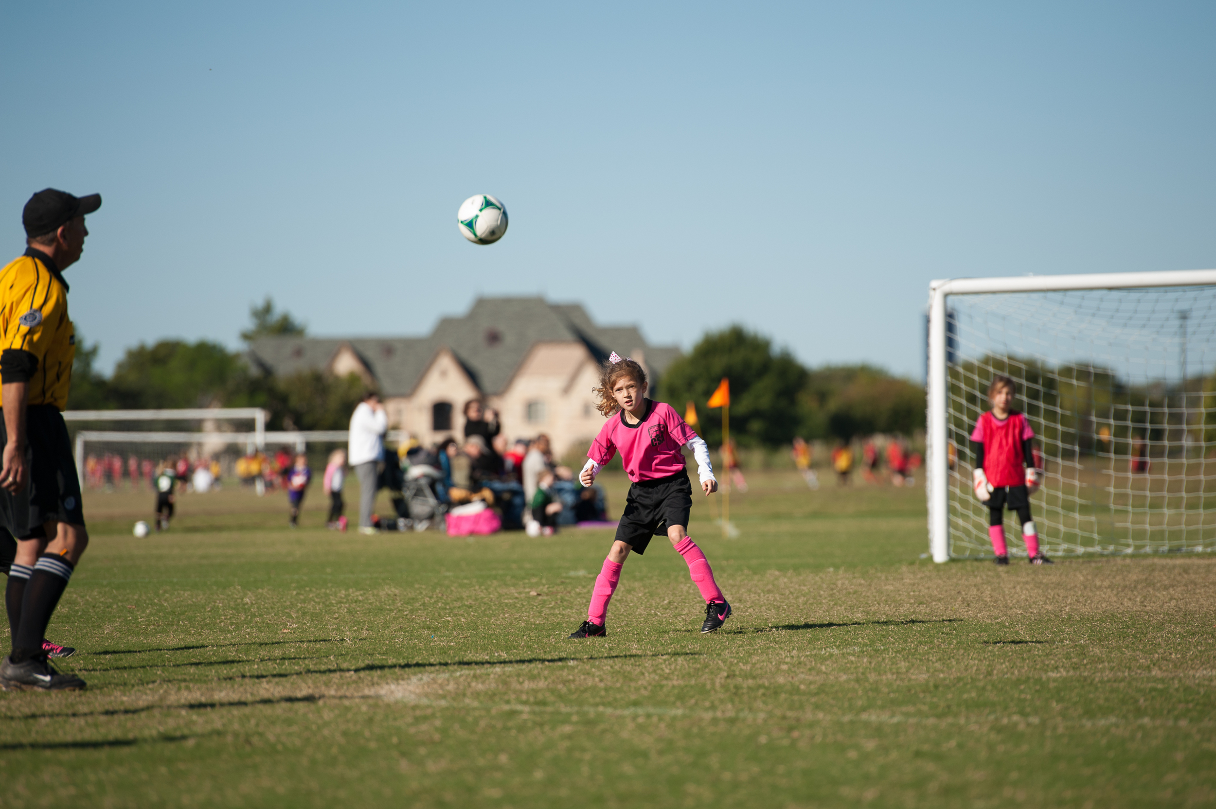 A moment earlier, I missed focus as our little defender kicked the crap out of this ball. Almost looks like she had head-butted it here!