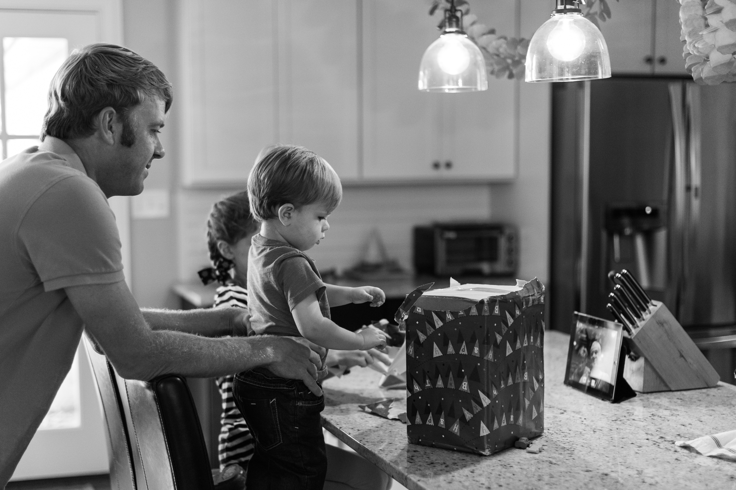 The morning started out with a Face Time session with Poppa and Gigi. Henry's biggest problem was fending off his big siblings so he could have some time to play with his new toys.