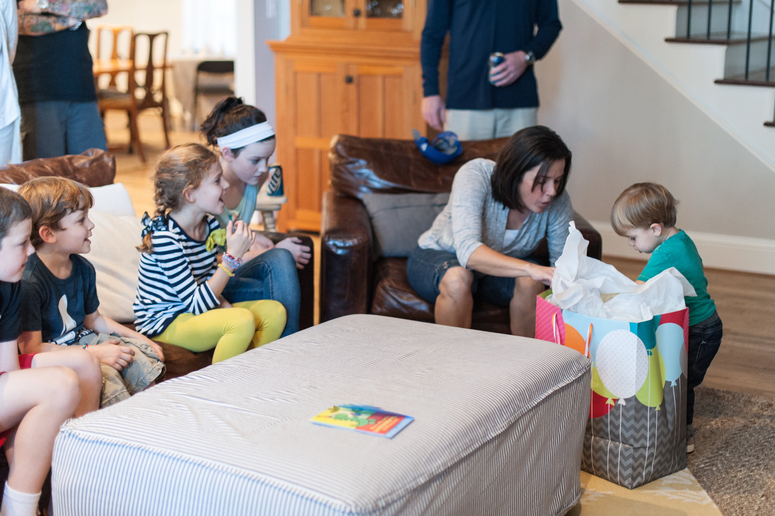 Following some stern words, the Peanut Gallery kept to the couch while Henry was coaxed into seeing what was in the bag.