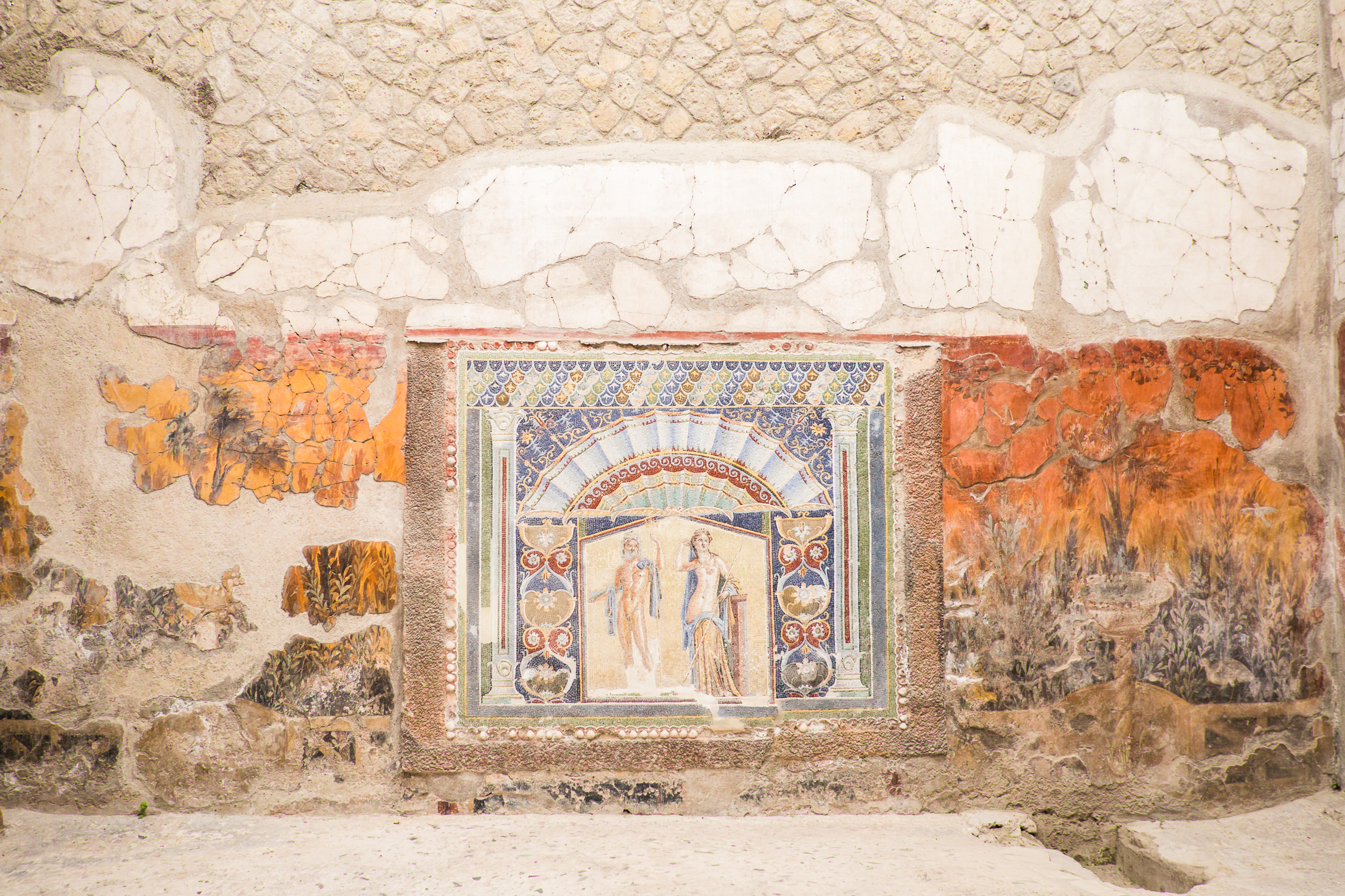 Two thousand years ago, these buildings, homes and courtyards were decorated with plaster, bright frescos and intricate mosaics.