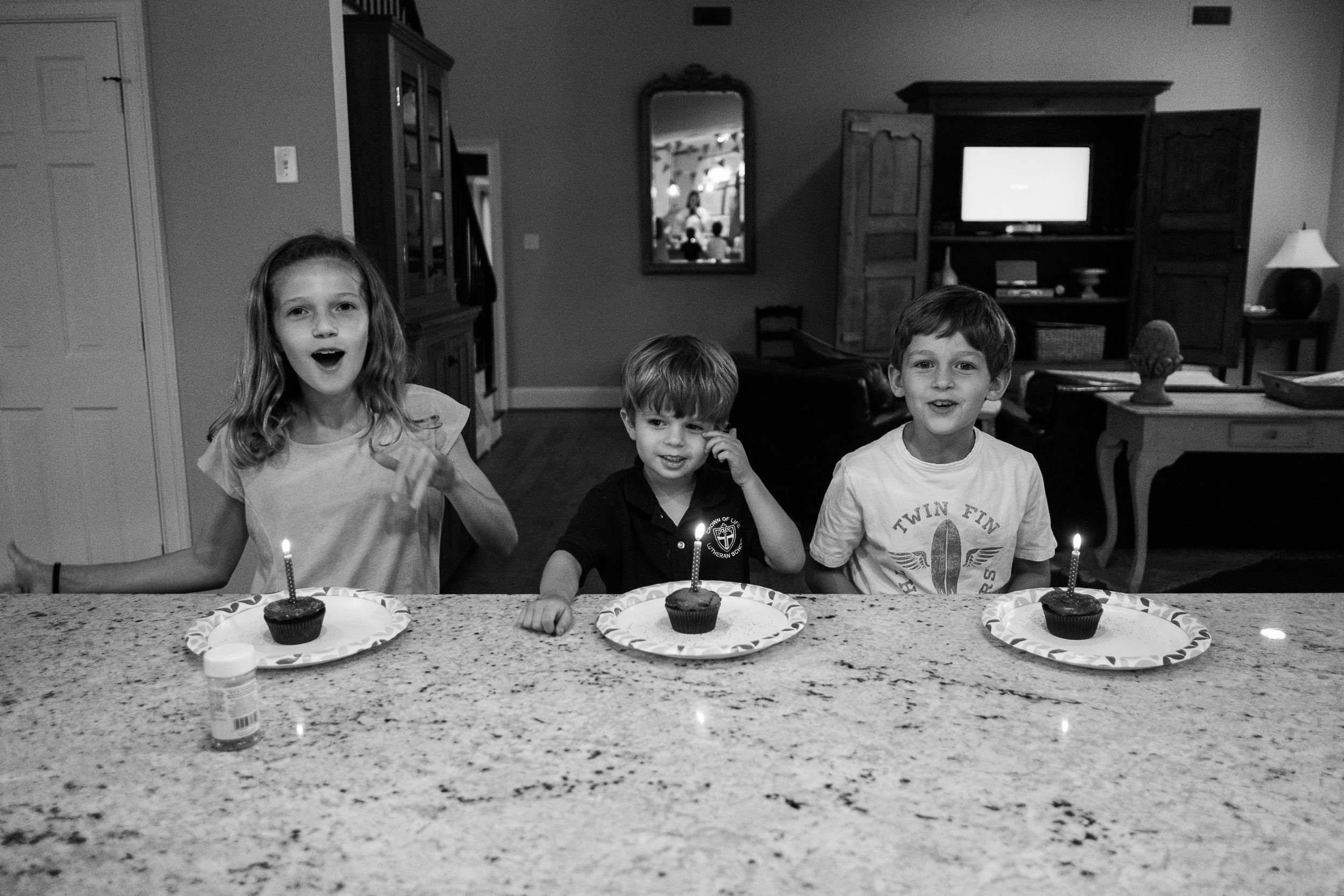 With the friends and family parties not happening until the weekend, we celebrated Michael's actual birthday with cupcakes after dinner. Naturally everyone had to have a lit candle. Wishes all-around!