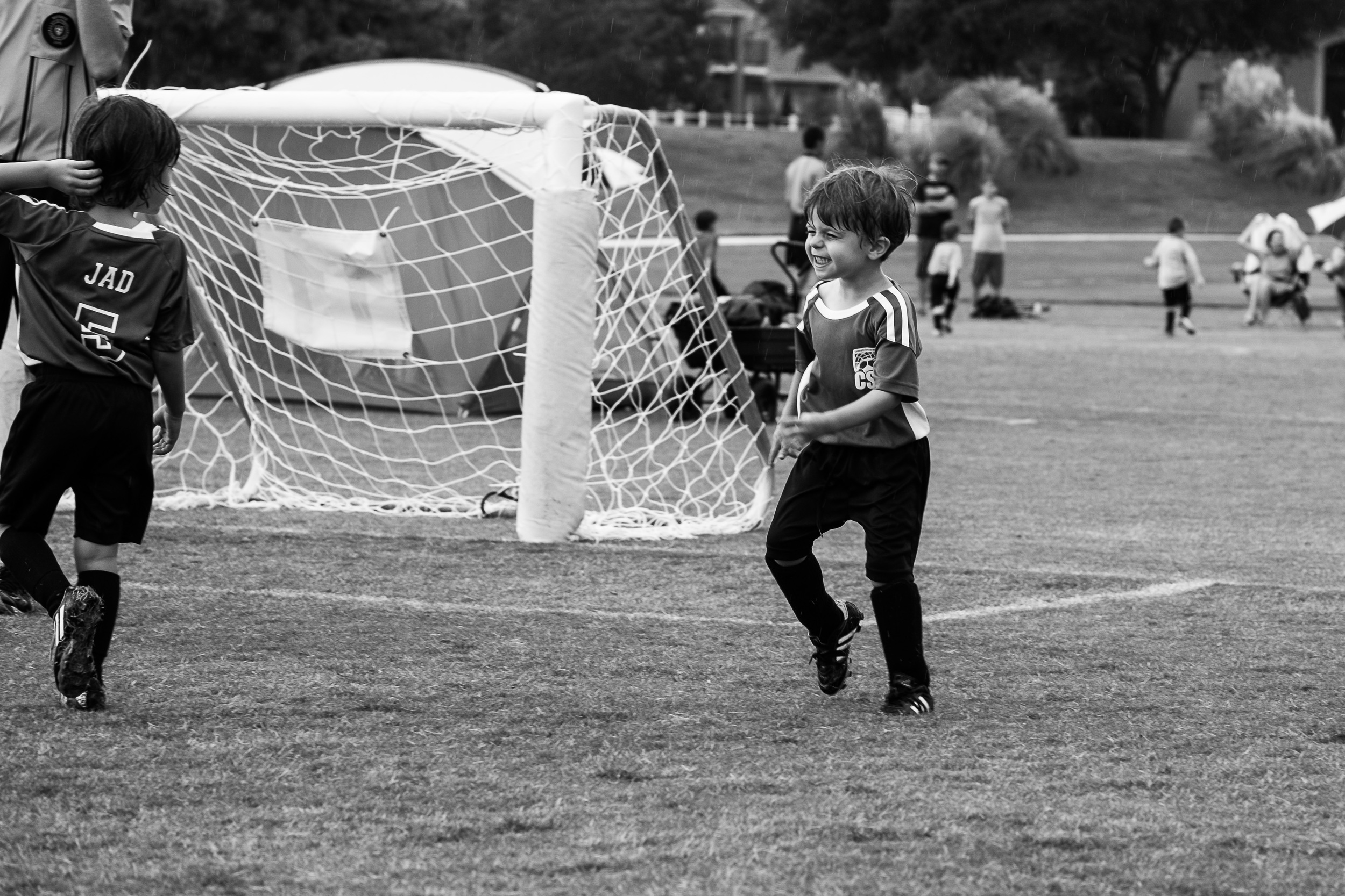 When you're three and you're playing soccer in the rain, you might just believe that life can't get any better than this.