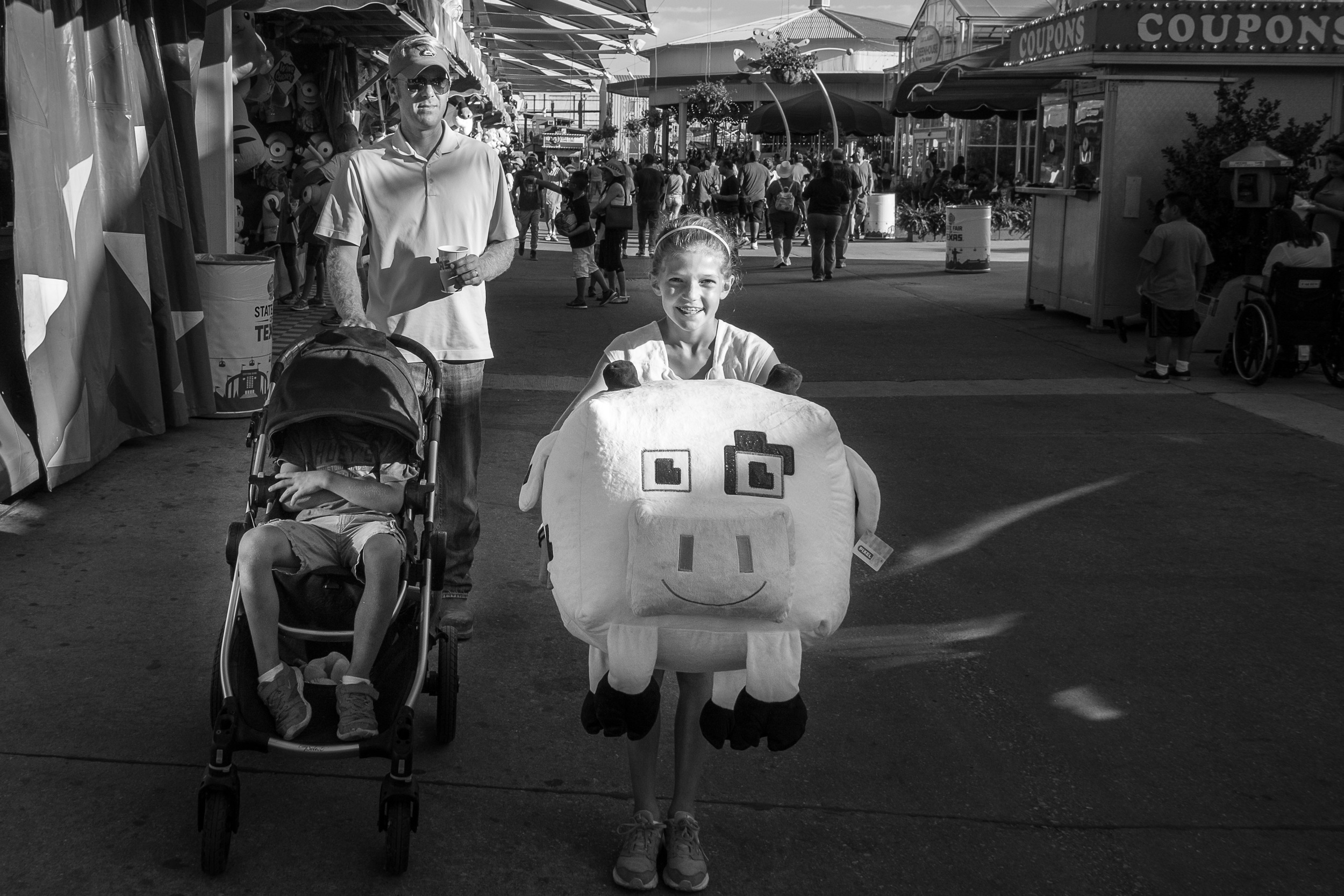 Ella won this massive Minecraft cow. Two things about this photo make me giggle.  1. Knowing how Ella is going to have to haul that thing around the fair for two more hours.  2. Her brother's temper tantrum while sitting in the stroller he's clearly outgrown. (Where's Henry?)