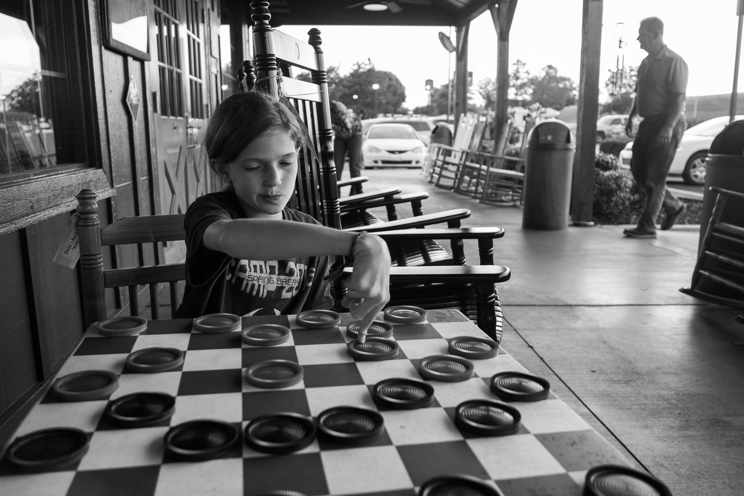 Saturday night, El and I took a quick break from the team to pick up some take-out from Cracker Barrel. Naturally we had to test out the oversized Checkers board and rocking chairs while we waited.