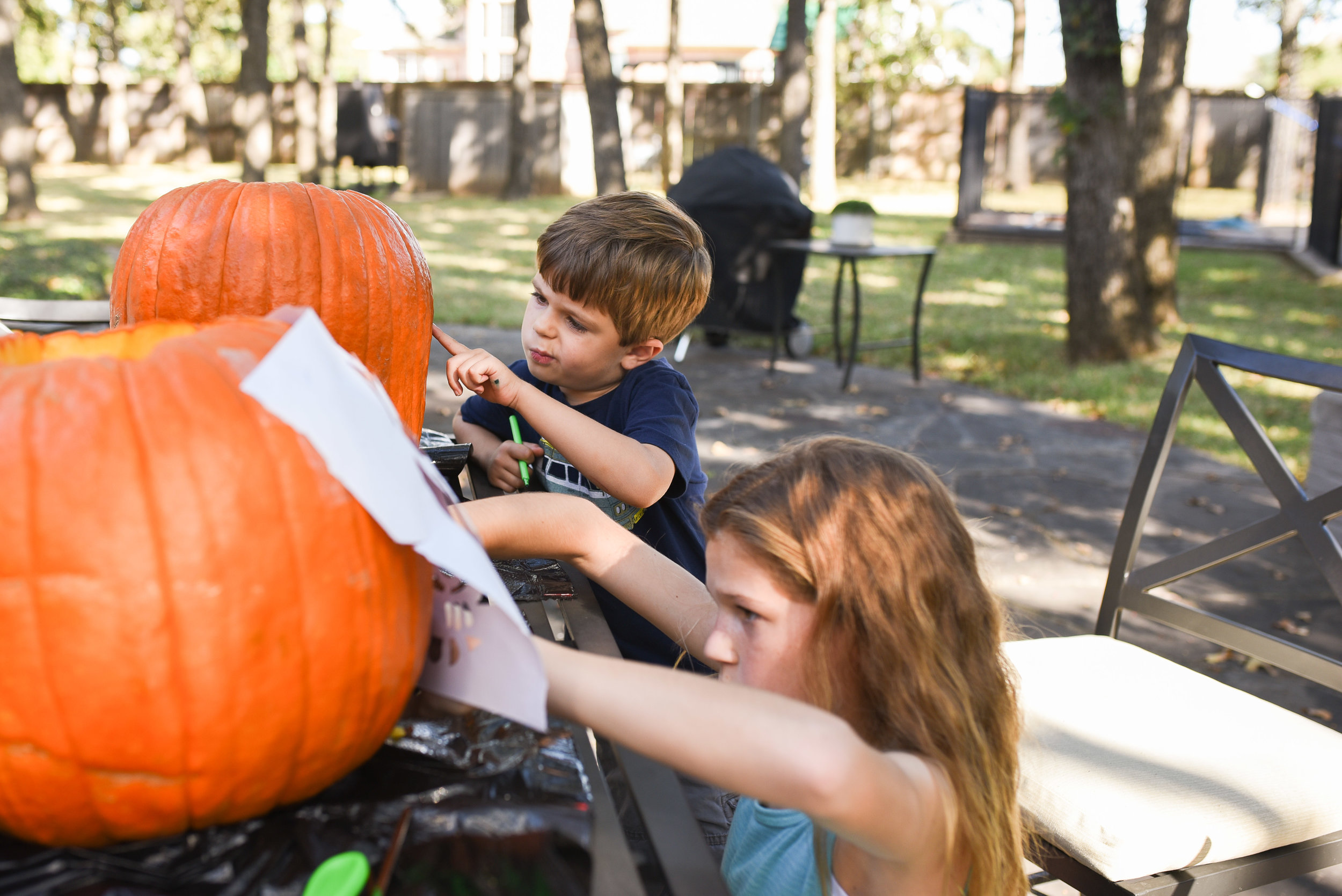 Since we celebrated Halloween on a crazy busy Saturday, carving our pumpkins waited until Sunday. Henry took his creative duties quite seriously.