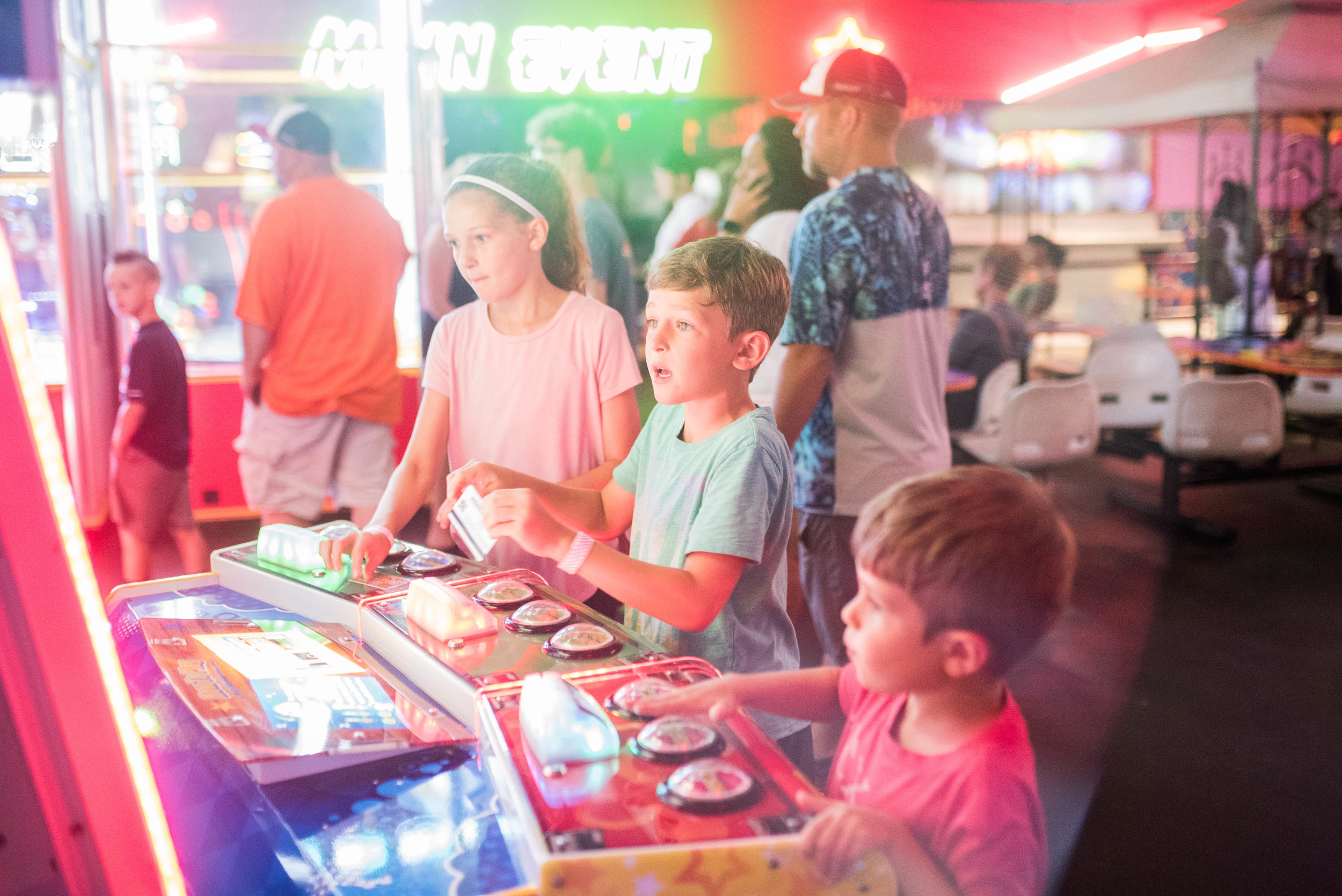When the beach day was a complete wash-out...we headed to the (super-overcrowded) skating rink and arcade.