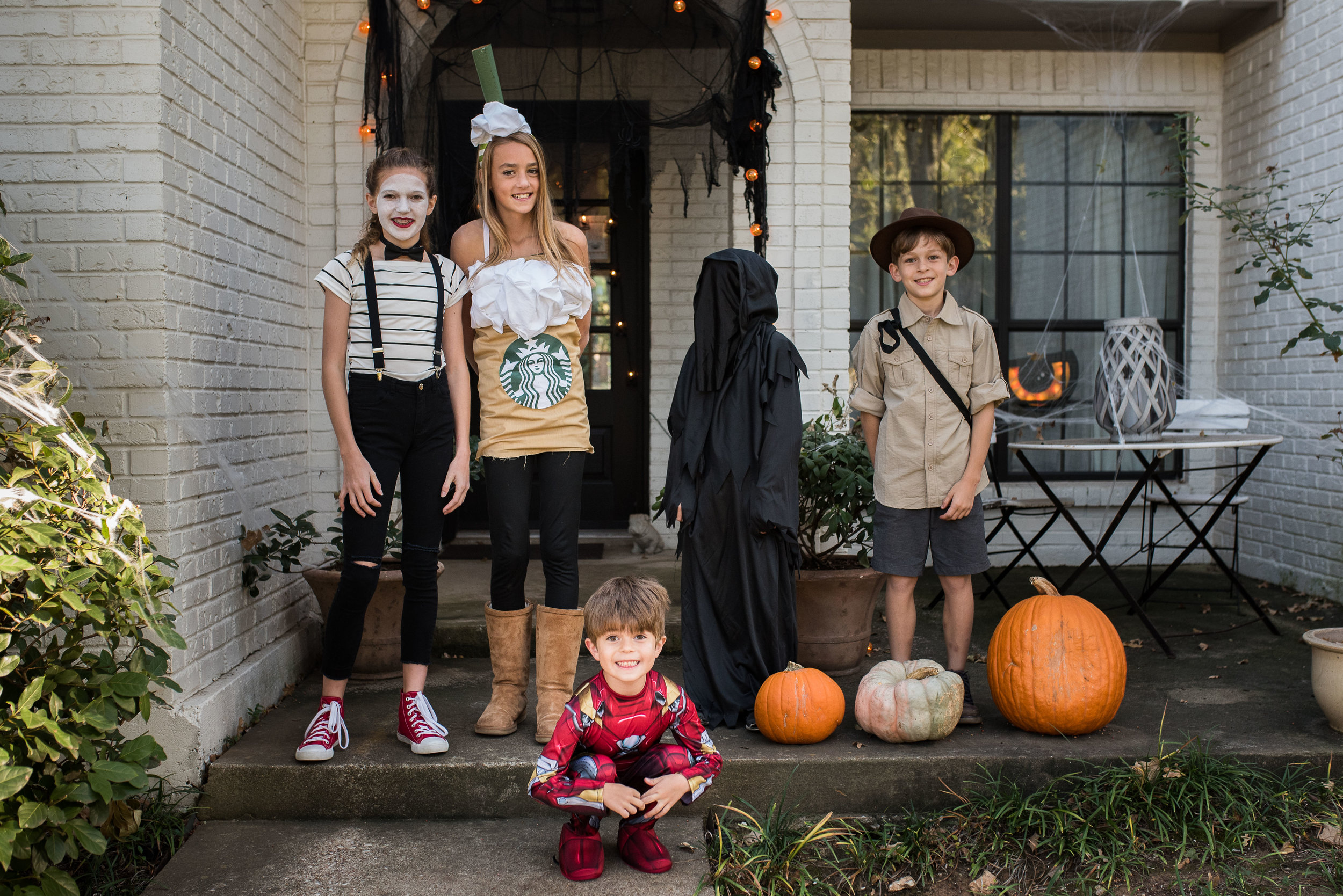 Happy Halloween! From our mime, her friend the Frappucino, Indiana Jones and his friend the Grim Reaper, and of course, Iron Man (who decided he didn't like the light-up mask and gloves he HAD to have.)