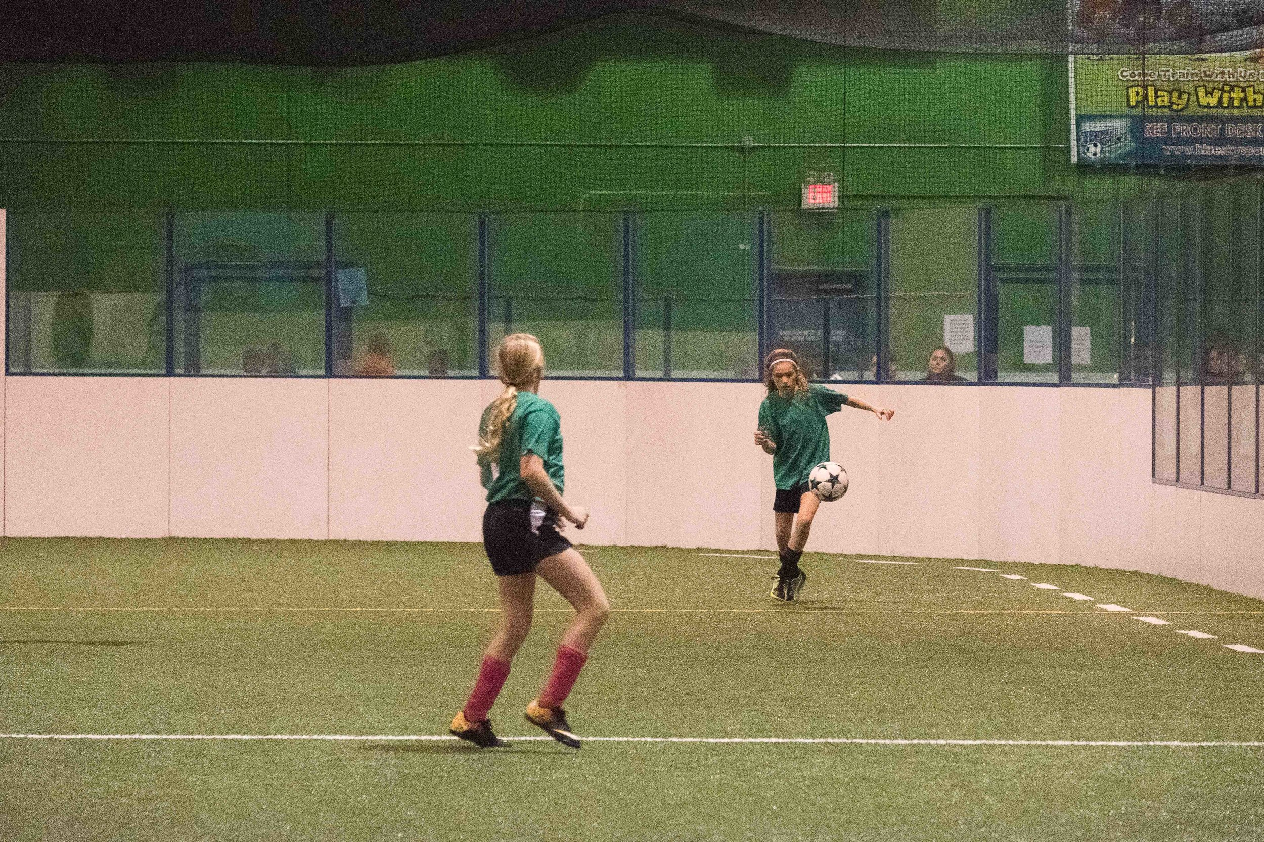 Ella played indoor soccer this winter. Under horrible lighting conditions.