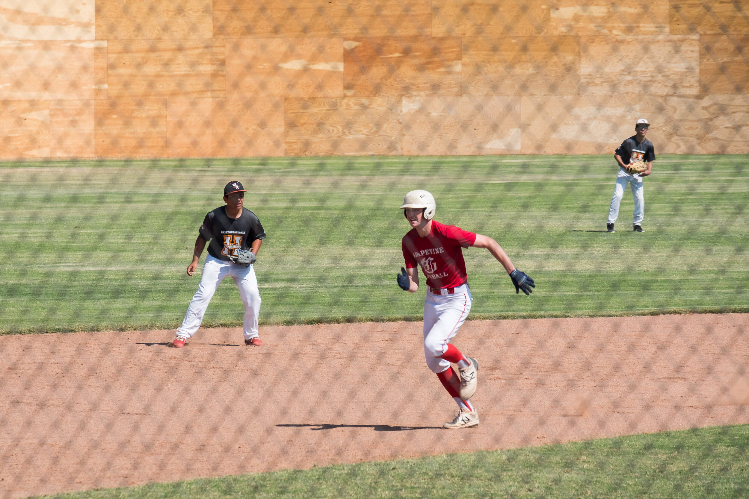 It was a 97-degree day in October, but we enjoyed the chance to watch #4 round the bases for the Grapevine team.