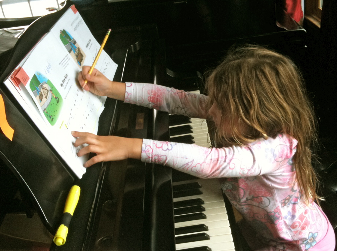 Sabine writing on her own music.