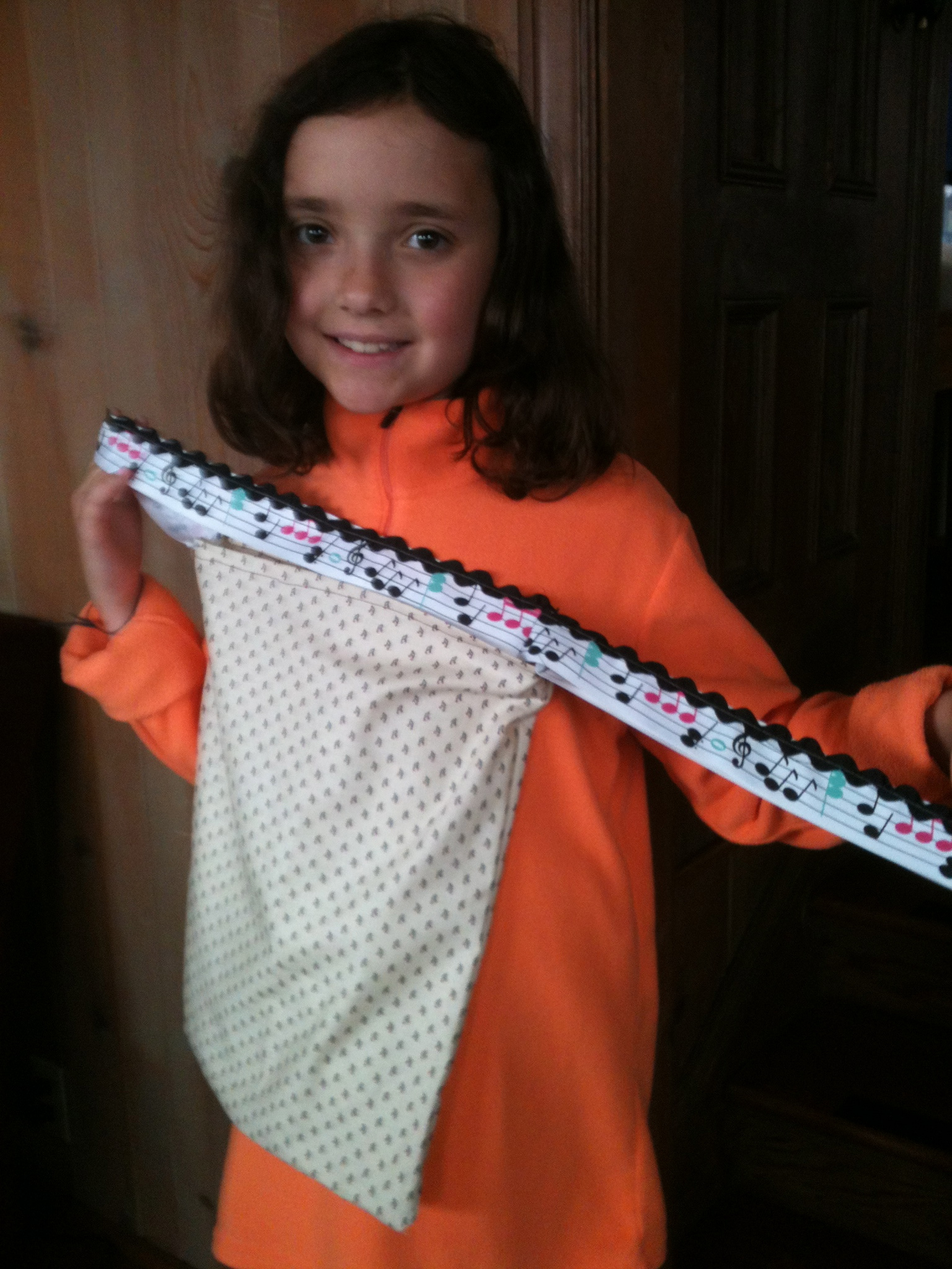 Maria shows off her new music bag. She made it herself. I love the ribbon she used to make the straps.