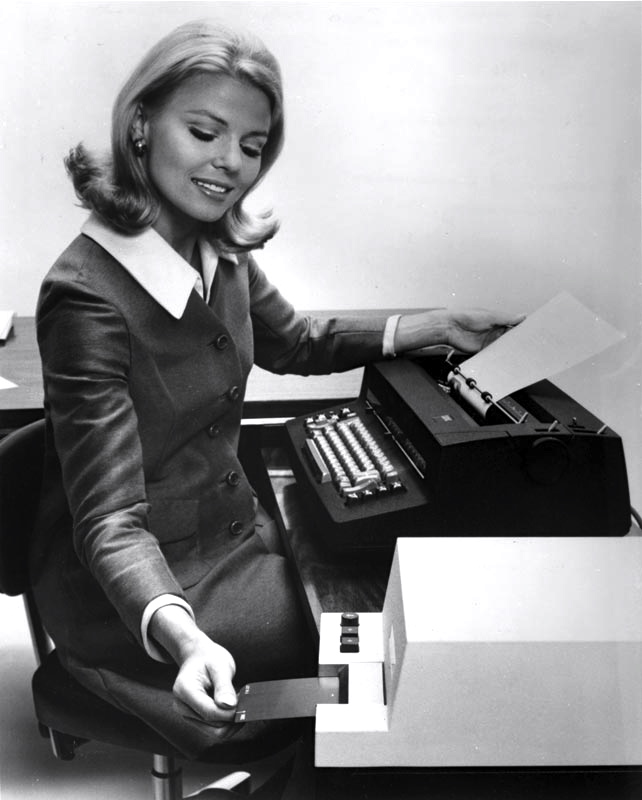 Steno pool girl with mag card typewriter.