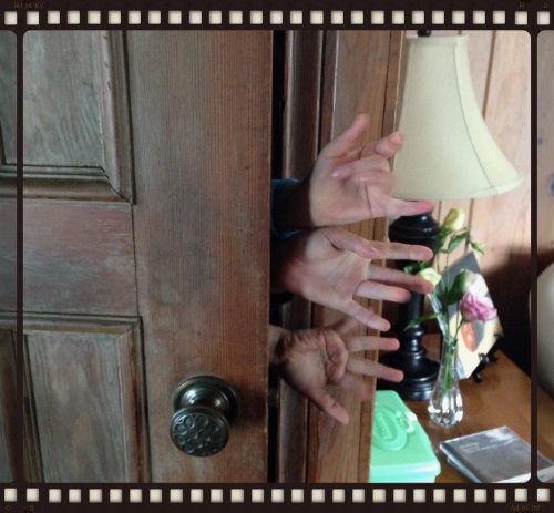 Mysterious hands emerging from the closet.