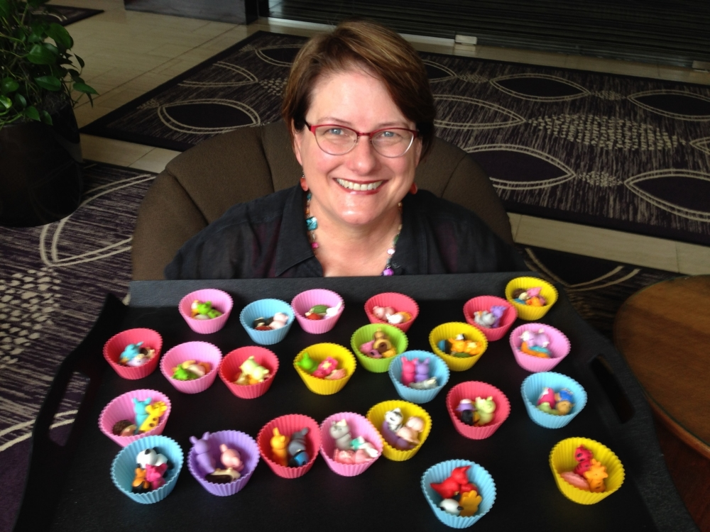 Diane with cupcakes full of  animal erasers .