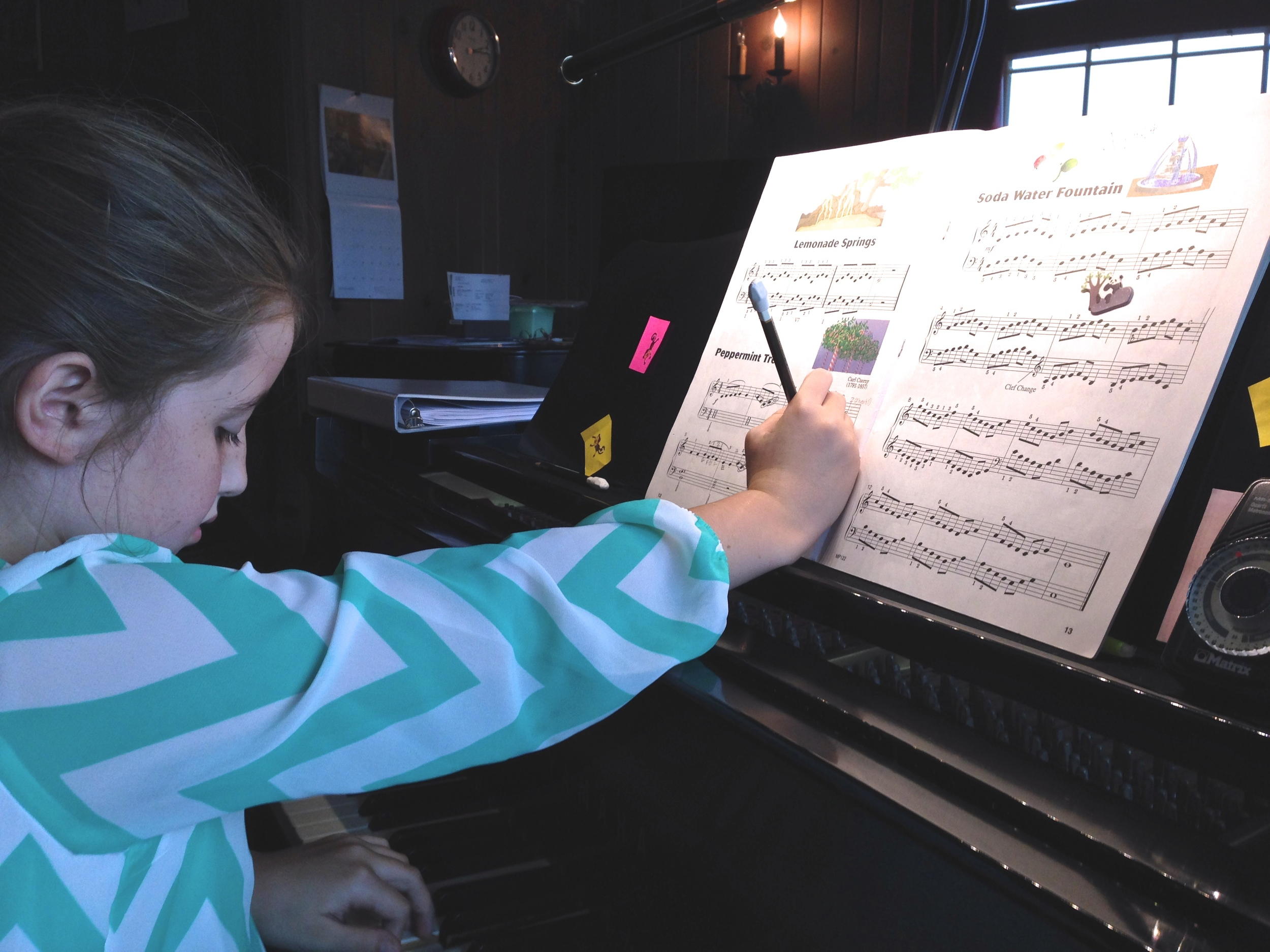Sabine at her lesson this week - circling the thirds and writing in her own fingering.