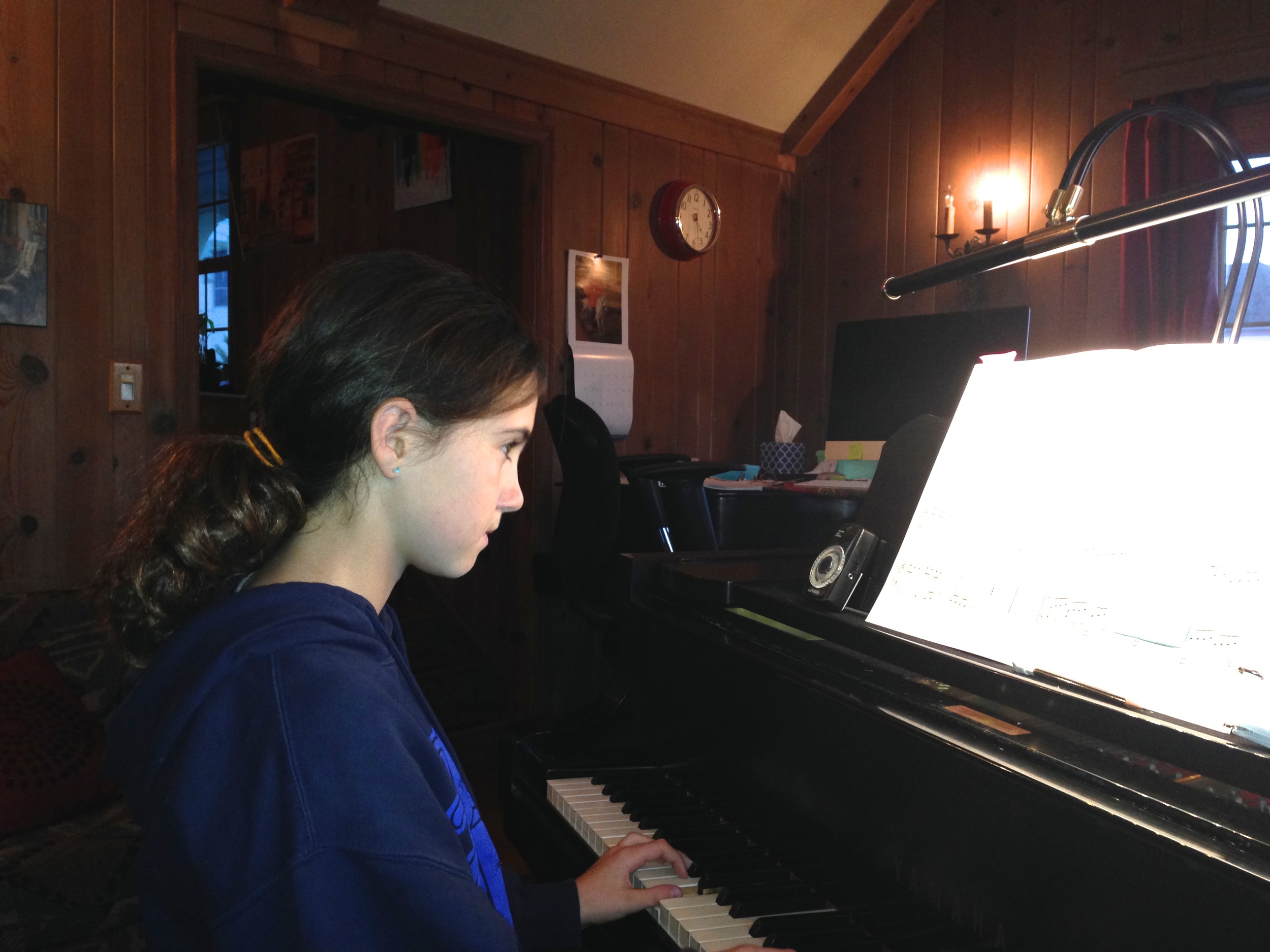 Dora concentrating hard to practice  One Line + One Measure .