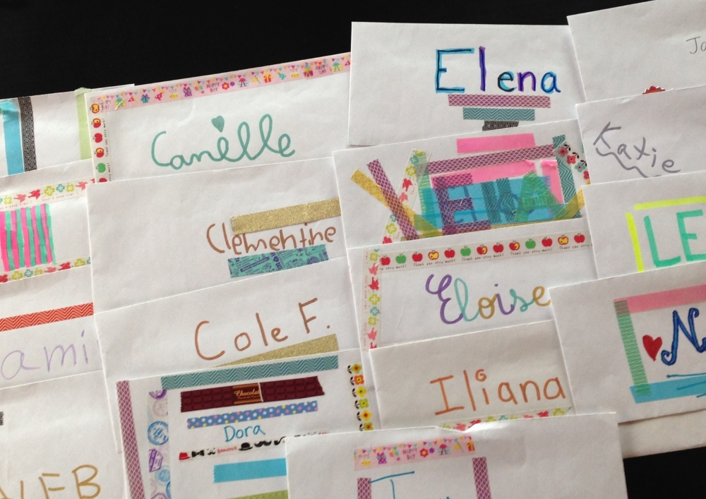 My students' Music Money envelopes decorated with highlighters and  washi tape .