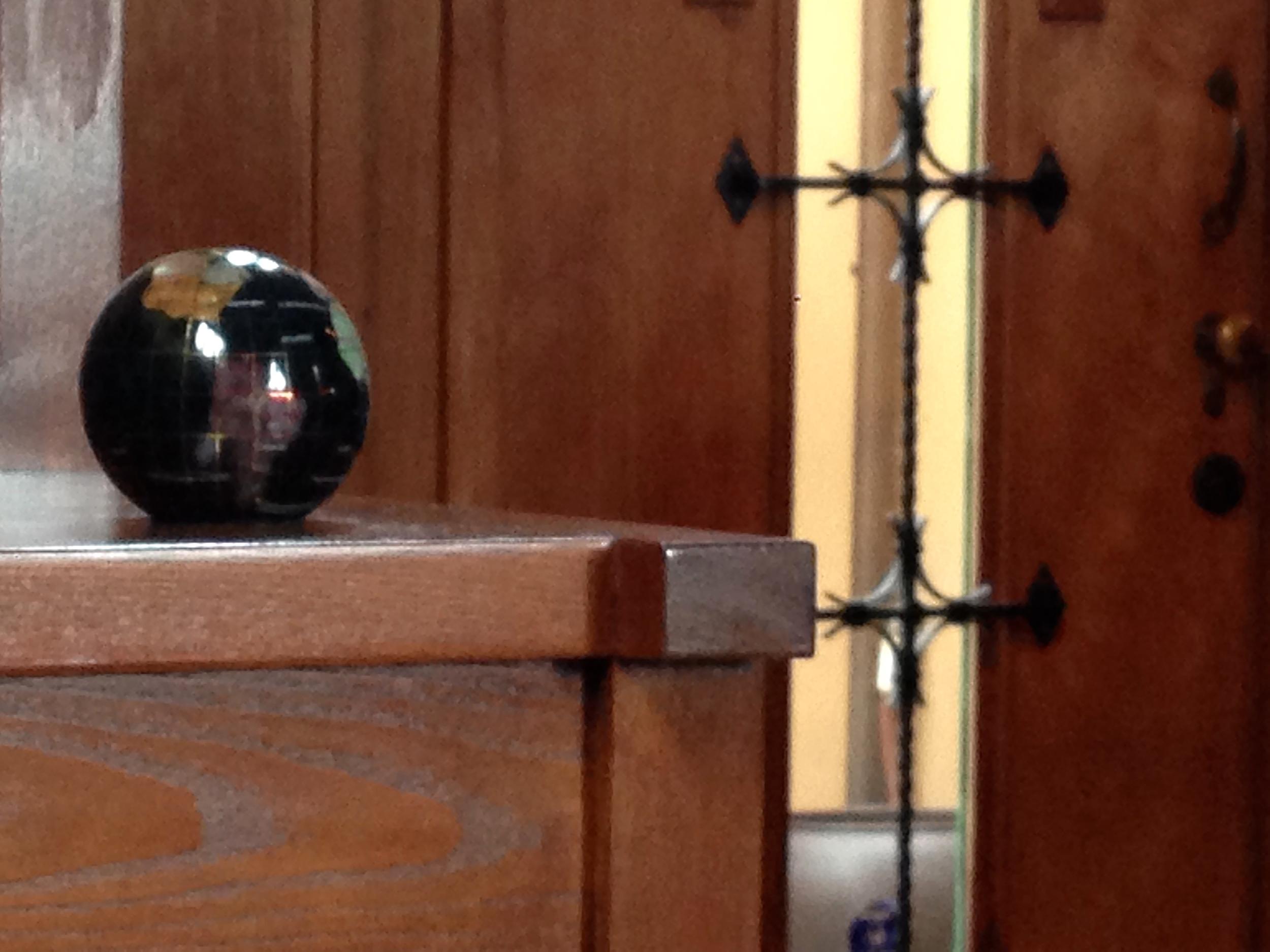 Globe on the stair step shelves.