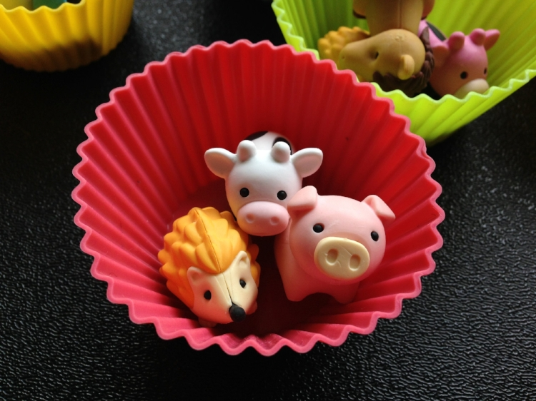 My students particularly like their erasers in  bright colored cupcake holders .