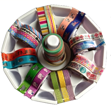 Here's my circular  washi tape dispenser , filled to the brim. I rotate through different kinds of tape to keep my students (and me) interested.