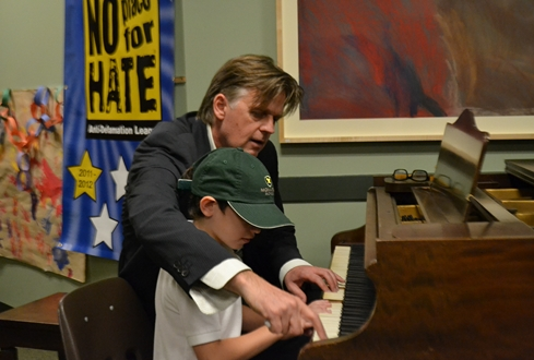 Stephen works with a young student at the Monarch School.