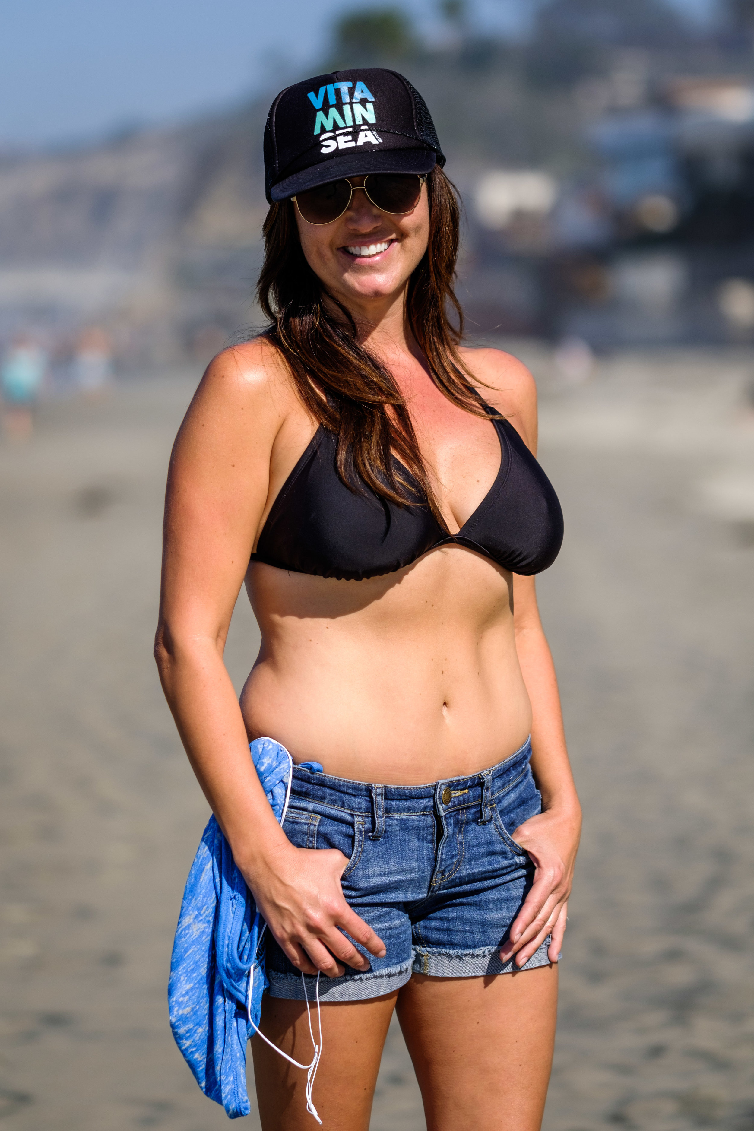 Here to watch her daughter compete in a surf competition. Said she hated photos of herself.