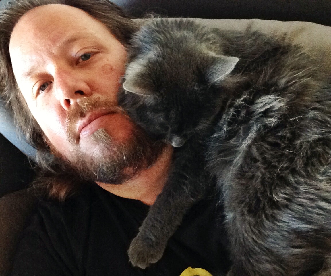 The Proprietor and his cat, Bear (right)