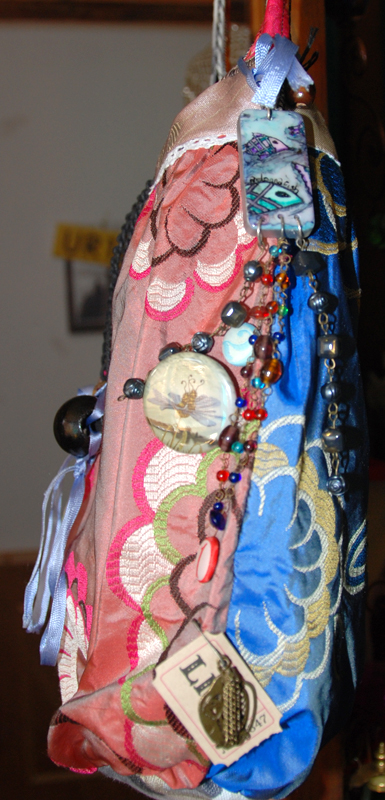 Freda Kahlo colour clash, a donna thing domino label with recipient DOB on reverse, and more embellishment