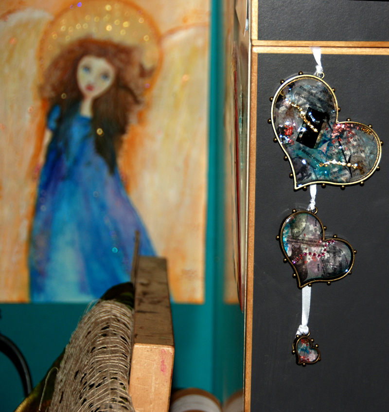 My ice resin bezels hanging out at home in my studio- my Christmas angel in the background, I'm thinking ice resin coronets....