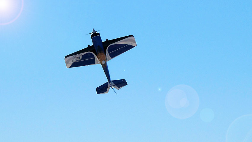 The Sbach 342 hangs in the air