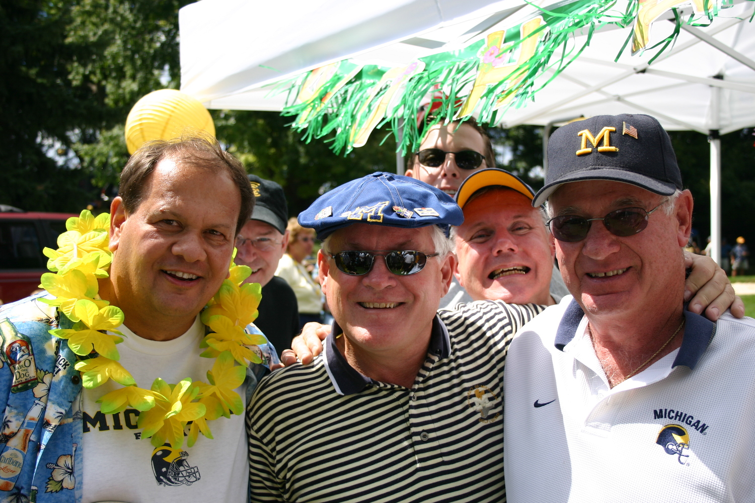 September 3, 2005:  Our first Luau themed tailgate, and the 100th consecutive game for Bubba and Stephen.  Pictured are The Godfather, Rubley (sp?), and Dogan...with a double photo bomb by Stephy and Captain Michigan.   Michigan defeated Northern Illinois 33-17.
