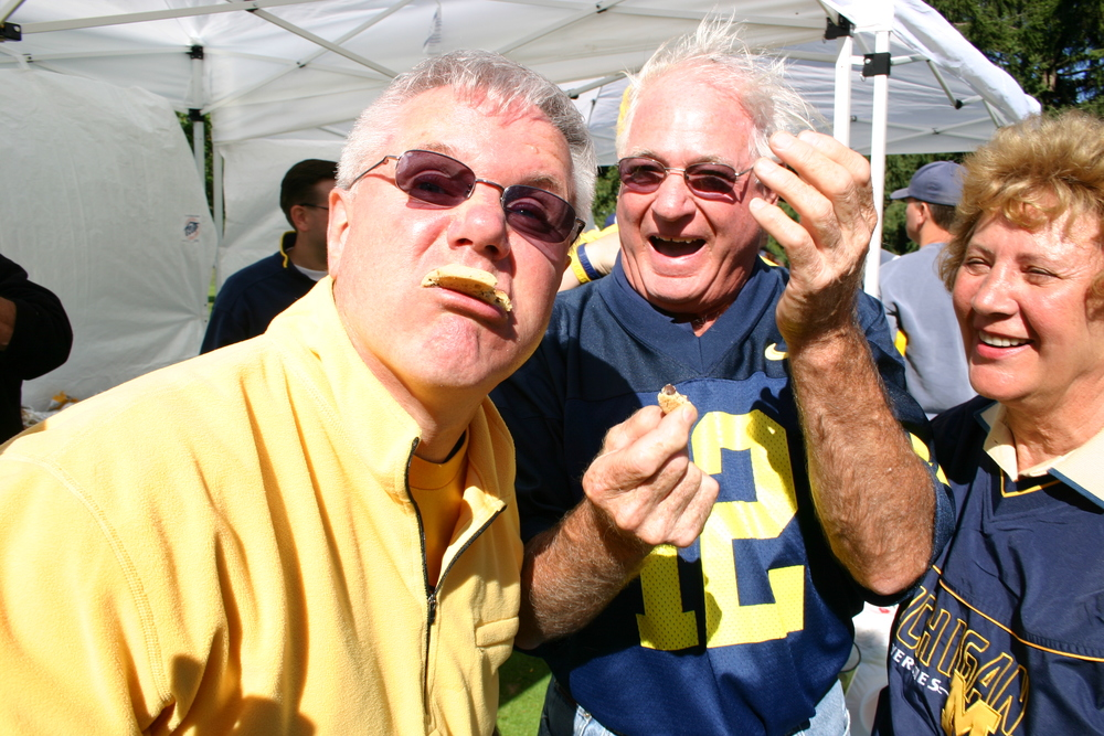 October 15, 2005:  Captain Michigan (back when he was fun) poses with the Dogans before Michigan's thrilling 27-25 victory over Penn State.  It was the best tailgate ever.