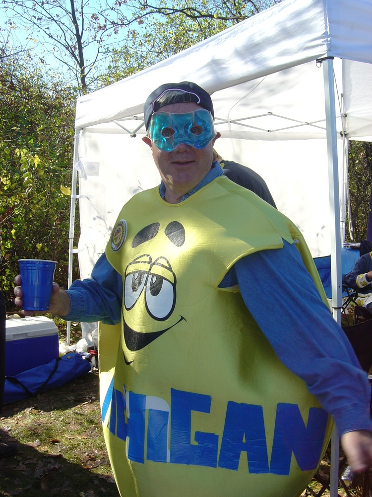 "October 30, 2004:  Captain Michigan dresses up as some kind of homeless and high M&M.  The back of this costume clearly reads ""EAT ME STATE.""  In the end it would prove lucky, as Braylon and the boys pulled out a 45-37 victory over the Spartans in triple overtime."