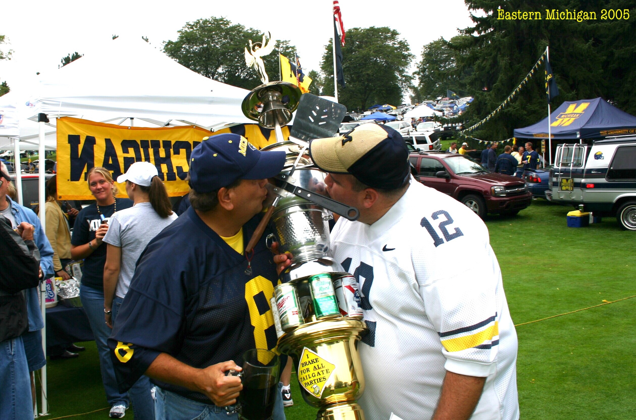 Godfather and Frankie kiss the Tailgate of the Week trophy before Michigan's 55-0 pasting of Eastern Michigan - September 17, 2005
