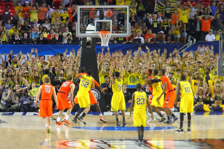 Burke ices the game from the line as Michigan defeats Syracuse in the final game of record for Michigan of the 2013 season.