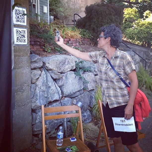 Participant scanning QR Codes