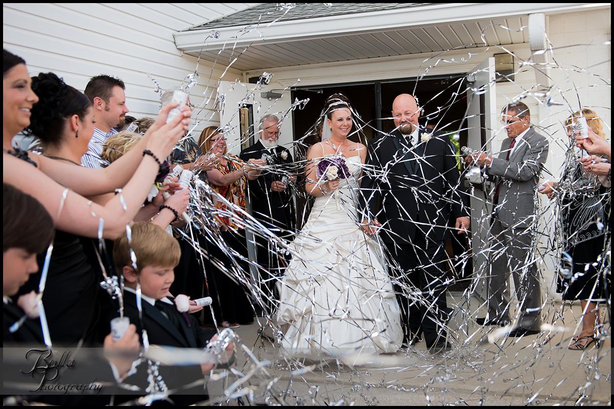 008_wedding_church_groom_bride_exit_streamers.jpg
