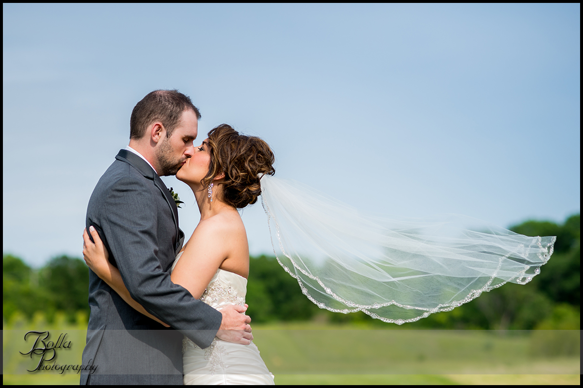001-villa-marie-winery-maryville-il-wedding-bride-groom-kiss-veil.jpg