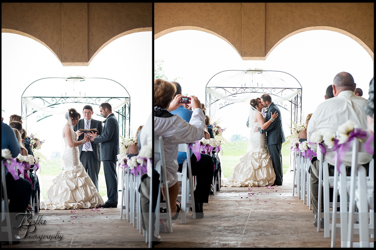 010-villa-marie-winery-maryville-il-wedding-bride-groom-outdoor-ceremony-rings-first-kiss.jpg