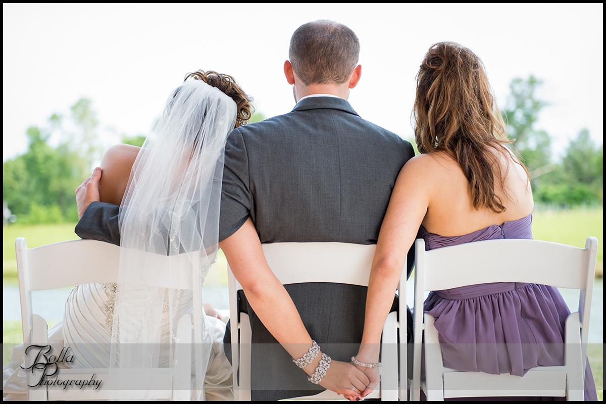 012-villa-marie-winery-maryville-il-wedding-bride-groom-outdoor-portrait-hands-maid-of-honor.jpg