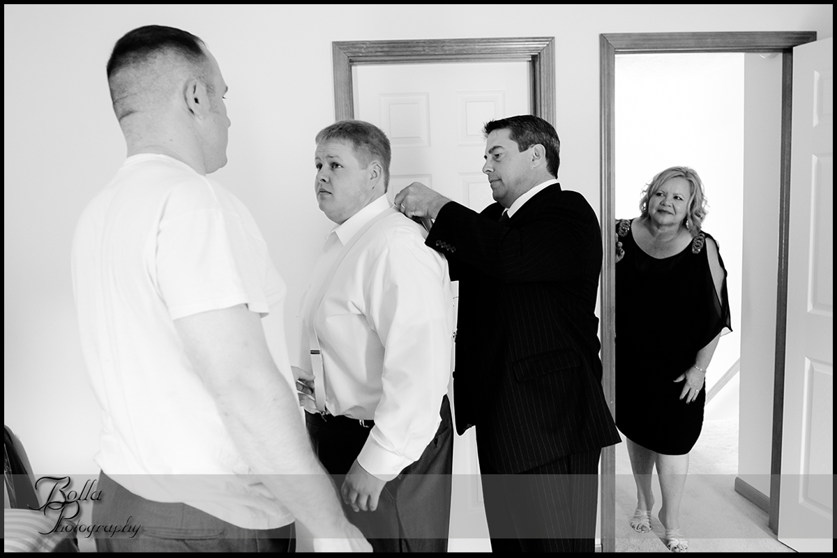 004-villa-marie-winery-maryville-il-wedding-groom-preparations-suspenders-father-mother.jpg